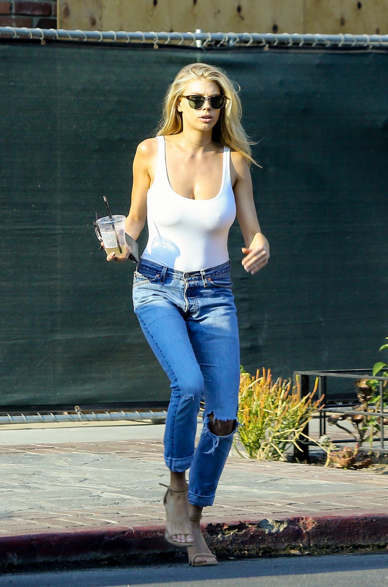 Charlotte Mckinney In White Tank And Blue Jeans Shopping