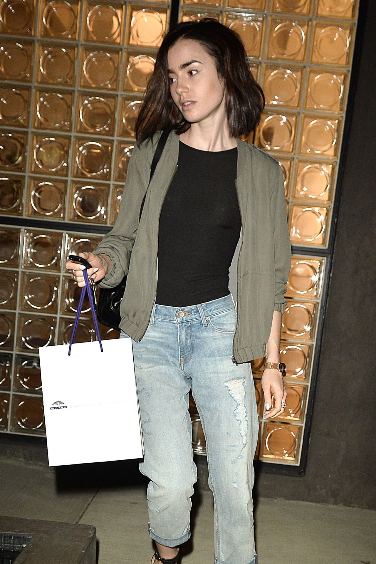 Lily Collins Leaving The Salon With Her Normal Hair Color In West