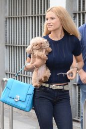 Michelle Hunziker - Carries Her Dog Lilly to a Media Appearance in Milan 9/2/2016
