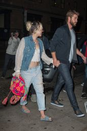 Miley Cyrus Holding Onto Liam Hemsworth