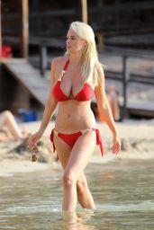 Rhian Sugden Hot in Red Bikini - Beach in Ibiza, September 2016