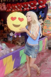 Sara Barrett Wins a Smiley Face Icon Pillow at the Fair in Malibu 9/4/2016