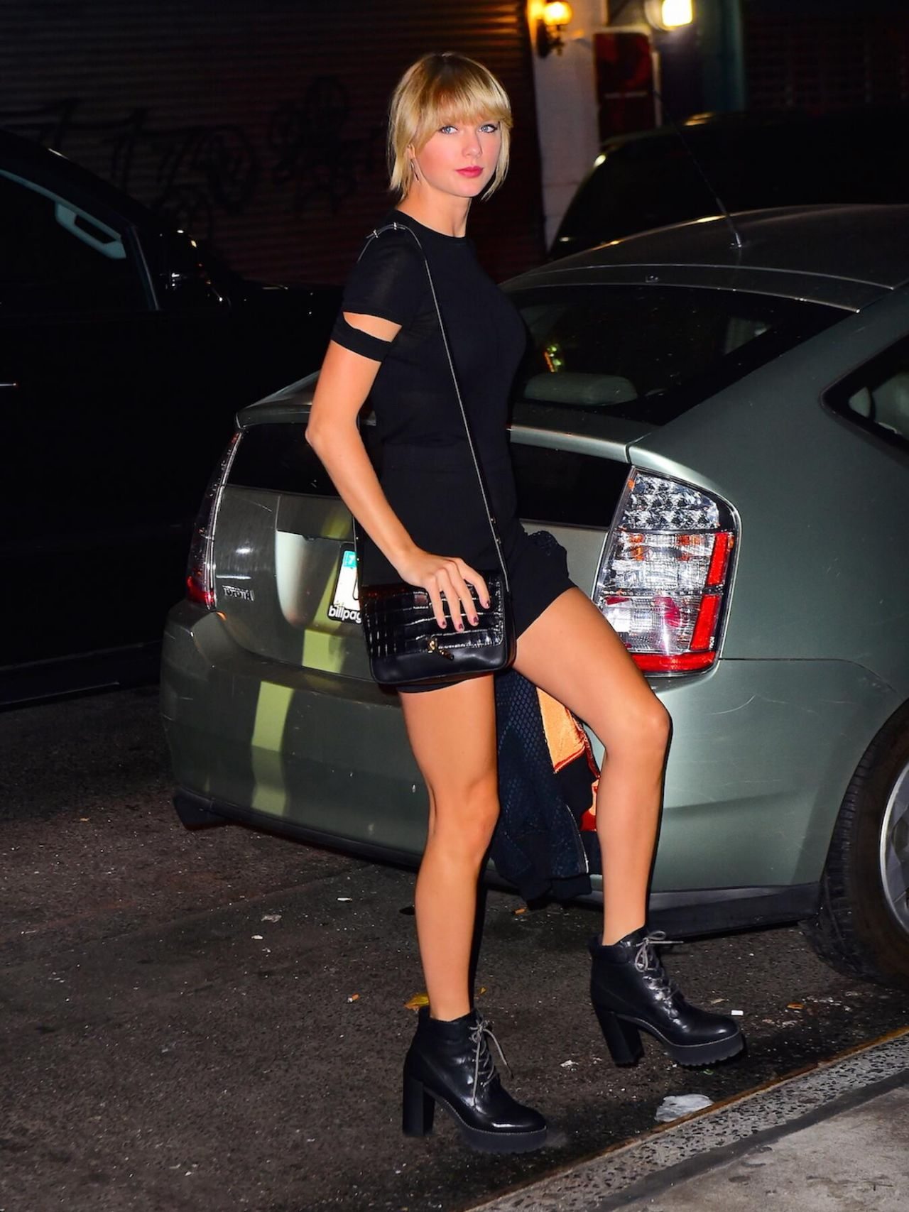Taylor Swift Sexy Little Black Dress and Chunky Boots