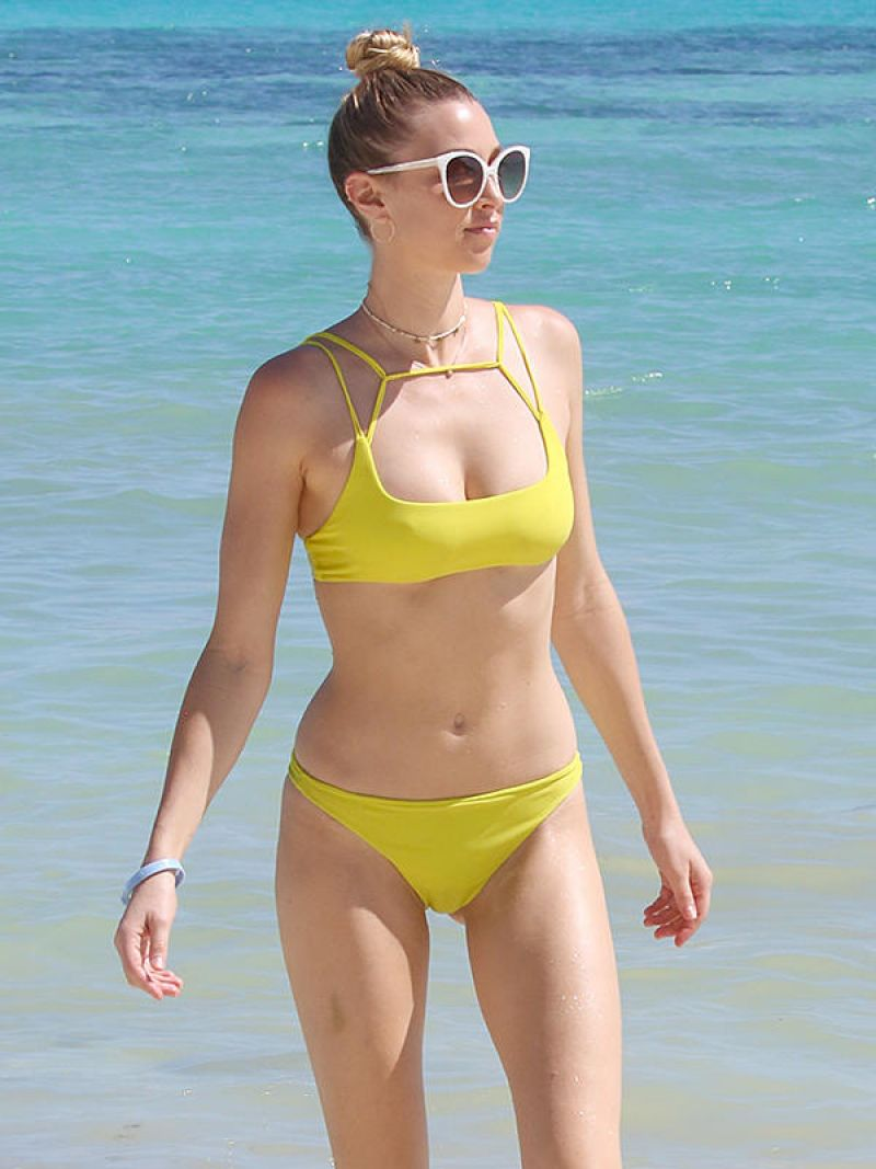 Whitney port shows off toned bod in a green bikini as she enjoys a day