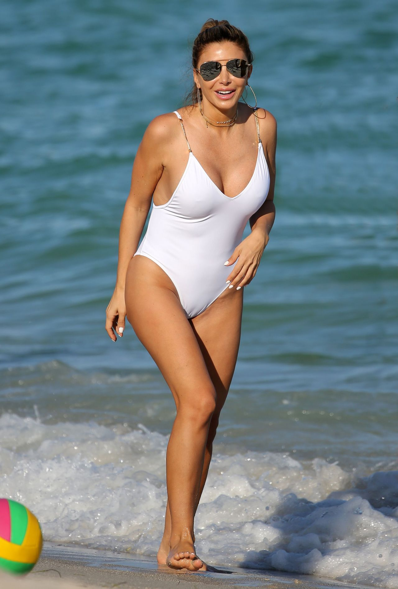 87e7db4632 Larsa Pippen Shows Off Her Curves in a White Swimsuit - Beach in Miami  11/13/ 2016