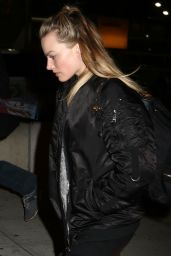 Margot Robbie Wears a Cry Baby Jacket - Arrives at JFK Airport in New York