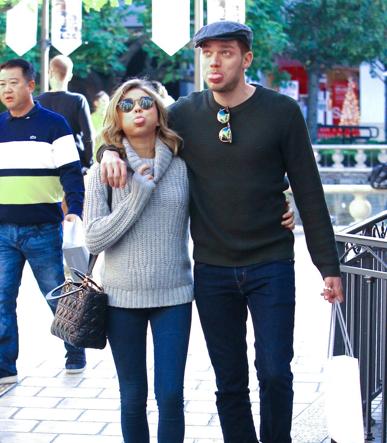 Sarah Hyland And Dominic Sherwood Christmas Shopping At