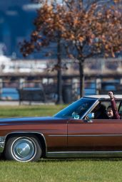Chloe Moretz - Driving a Vintage Cadillac DeVille Across a Park During a Photoshoot in New York City, DEcember 2016