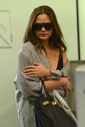 Chrissy Teigen - Arriving at Miami Airport 12/27/ 2016