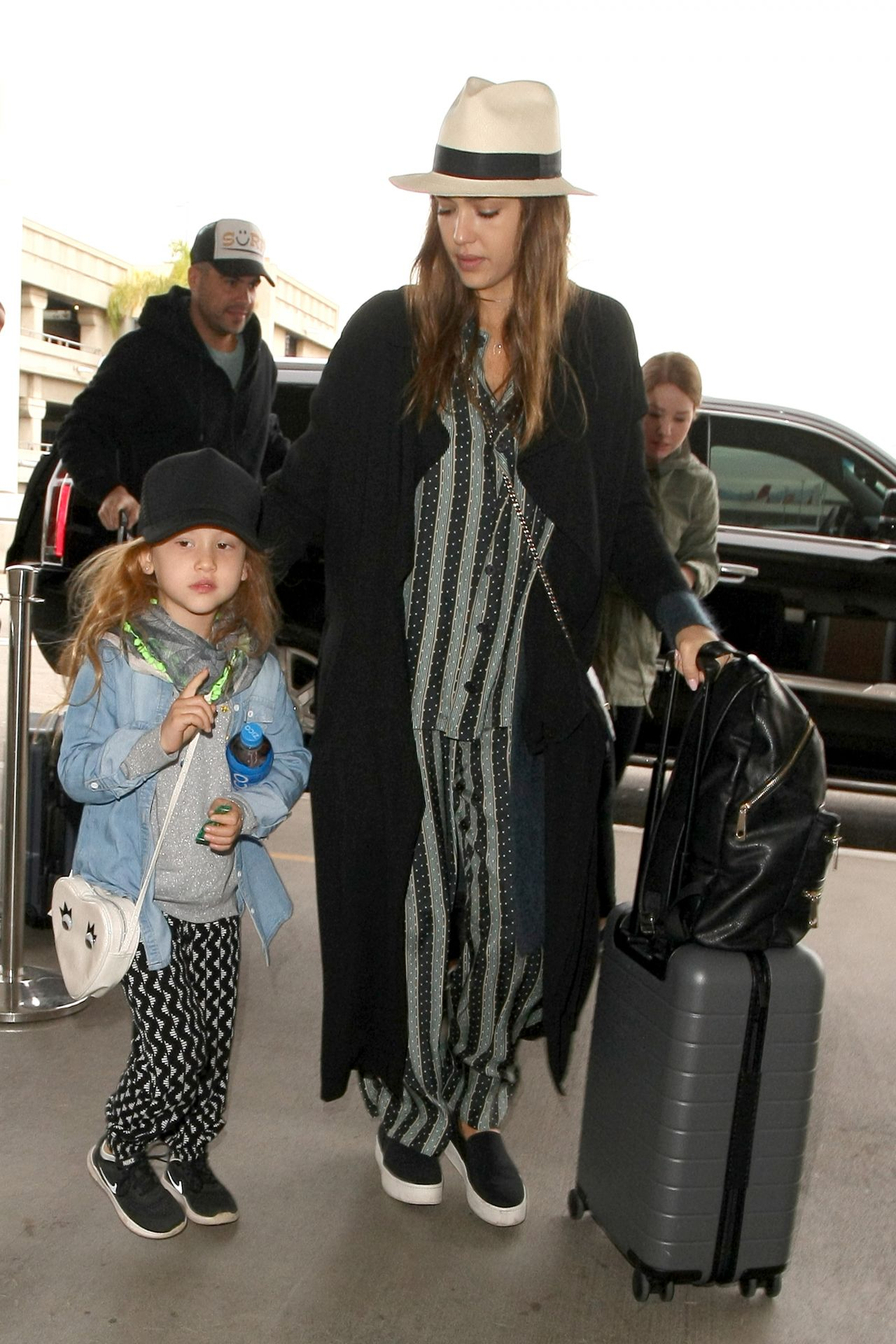 http://celebmafia.com/wp-content/uploads/2016/12/jessica-alba-arrives-at-lax-airport-in-los-angeles-12-26-2016-7.jpg