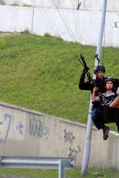 Nina Dobrev - Makes Paragliding Jump in Rio, Brazil, December 2016
