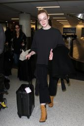 Elle Fanning - Arrives Back in Los Angeles 1/26/ 2017