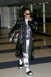 Rihanna Plays Coy With the Cameras - Arrives to JFK Airport from London 1/2/ 2017