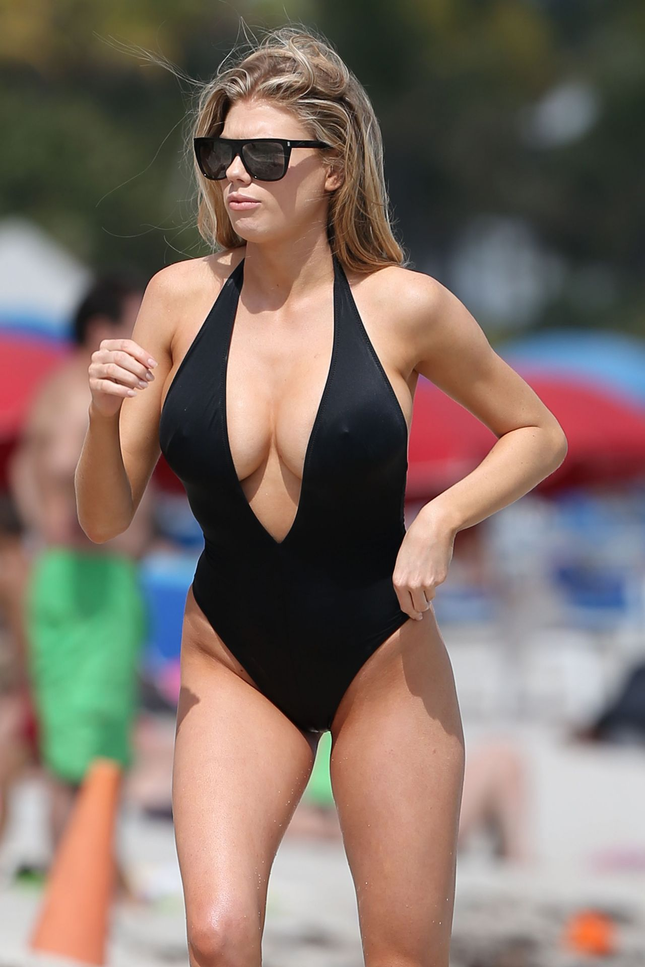 Charlotte Mckinney In Black Swimsuit At The Beach With Her