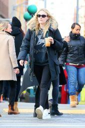 Dakota Fanning - Enjoying a Cold Beverage - Manhattan 2/21/ 2017