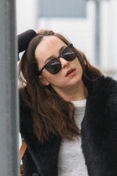 Dakota Johnson - Arriving at Heathrow Airport in London 02/10/ 2017