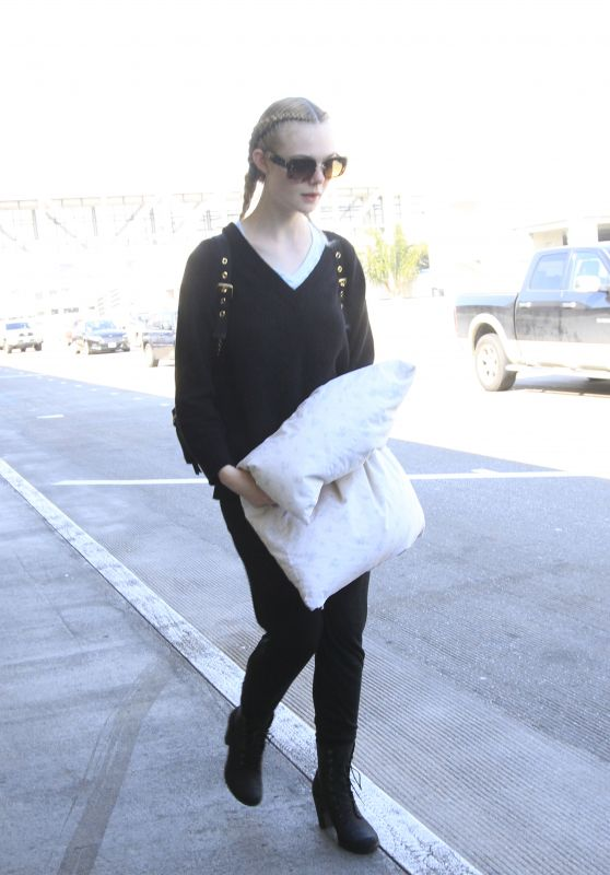 Elle Fanning - Arrives in Los Angeles 3/13/ 2017