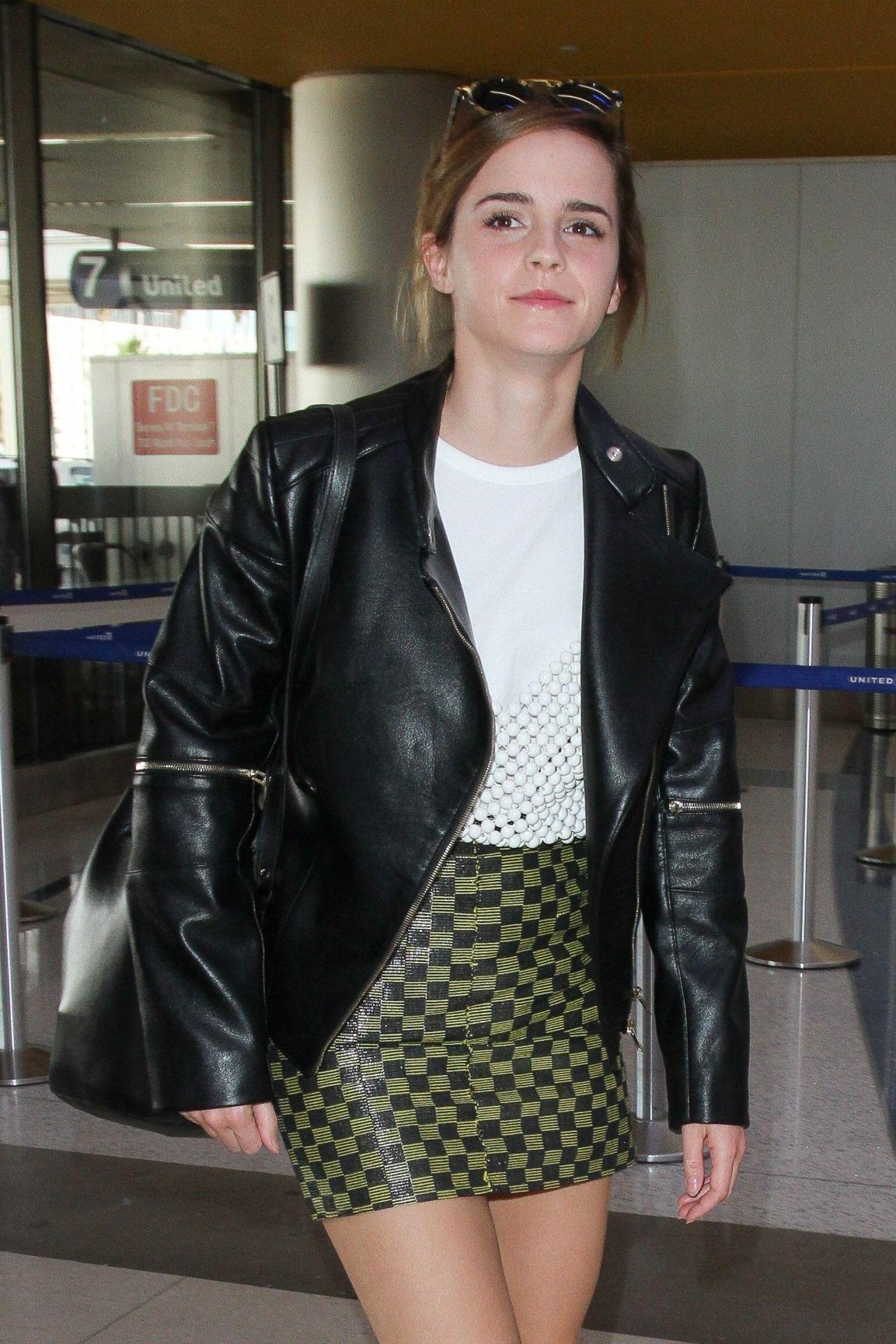 emma watson leggy in mini skirt arrives at los angeles