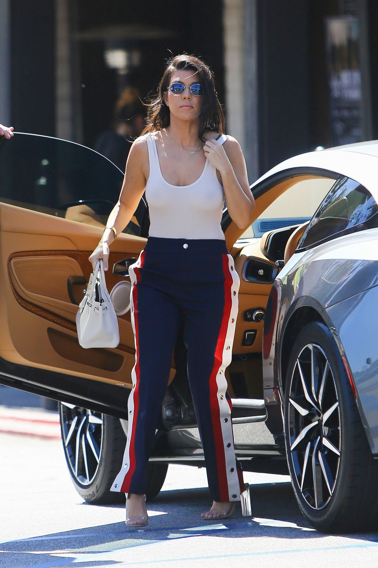 Kourtney Kardashian And Her Gunmetal Grey Aston Martin