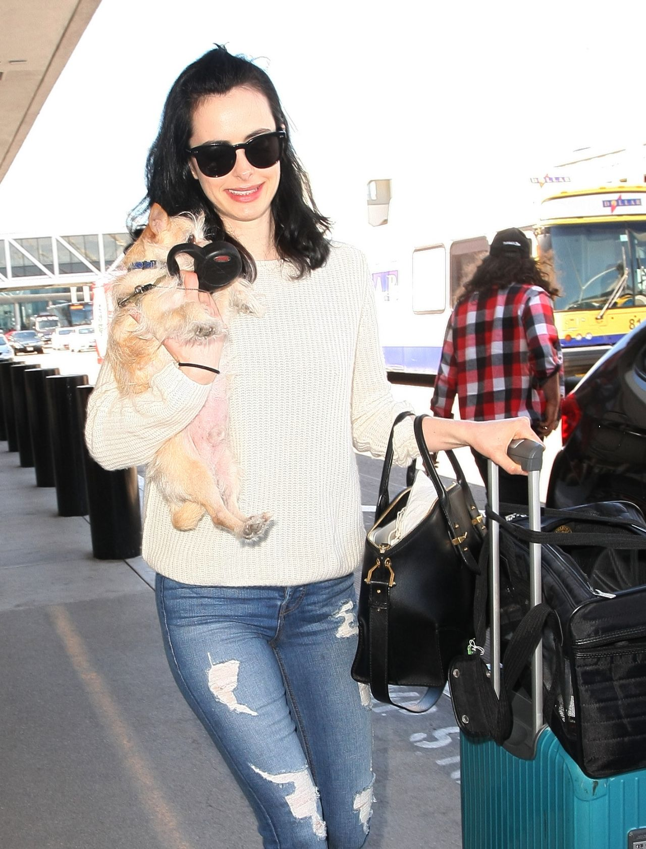 Krysten ritter jets out of lax in los angeles