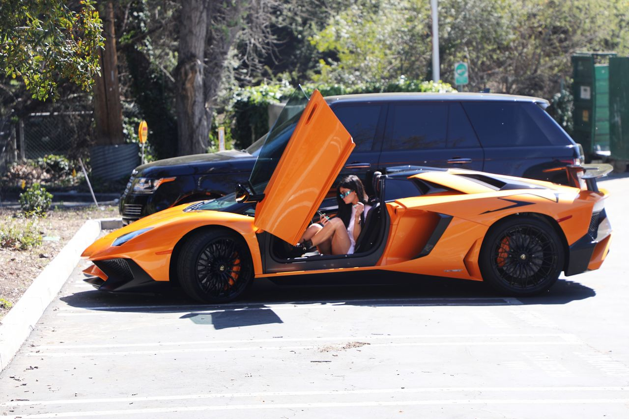 kylie jenner stepping out of her orange lamborghini aventador roadster los angeles 03 11 2017