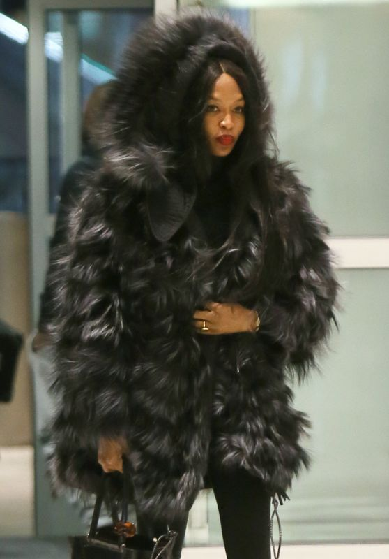 Naomi Campbell Keeps Warm in a Large Fur Coat - JFK AIrport in NY 3/11/ 2017
