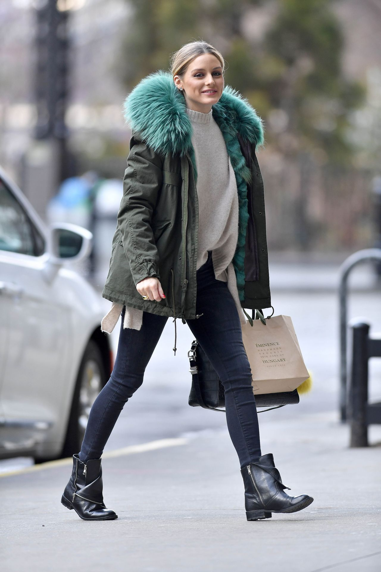 Olivia Palermo Wearing A Green Jacket And Black Boots
