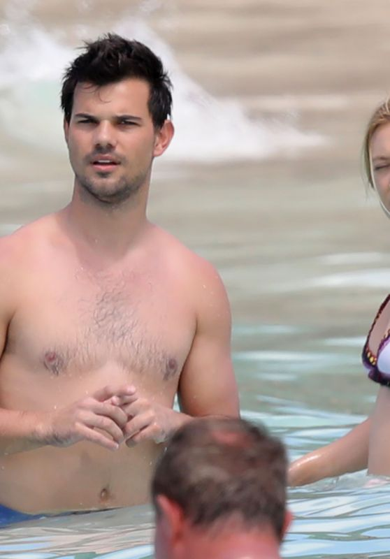 Billie Lourd And Beau Taylor Lautner At A Beach In St