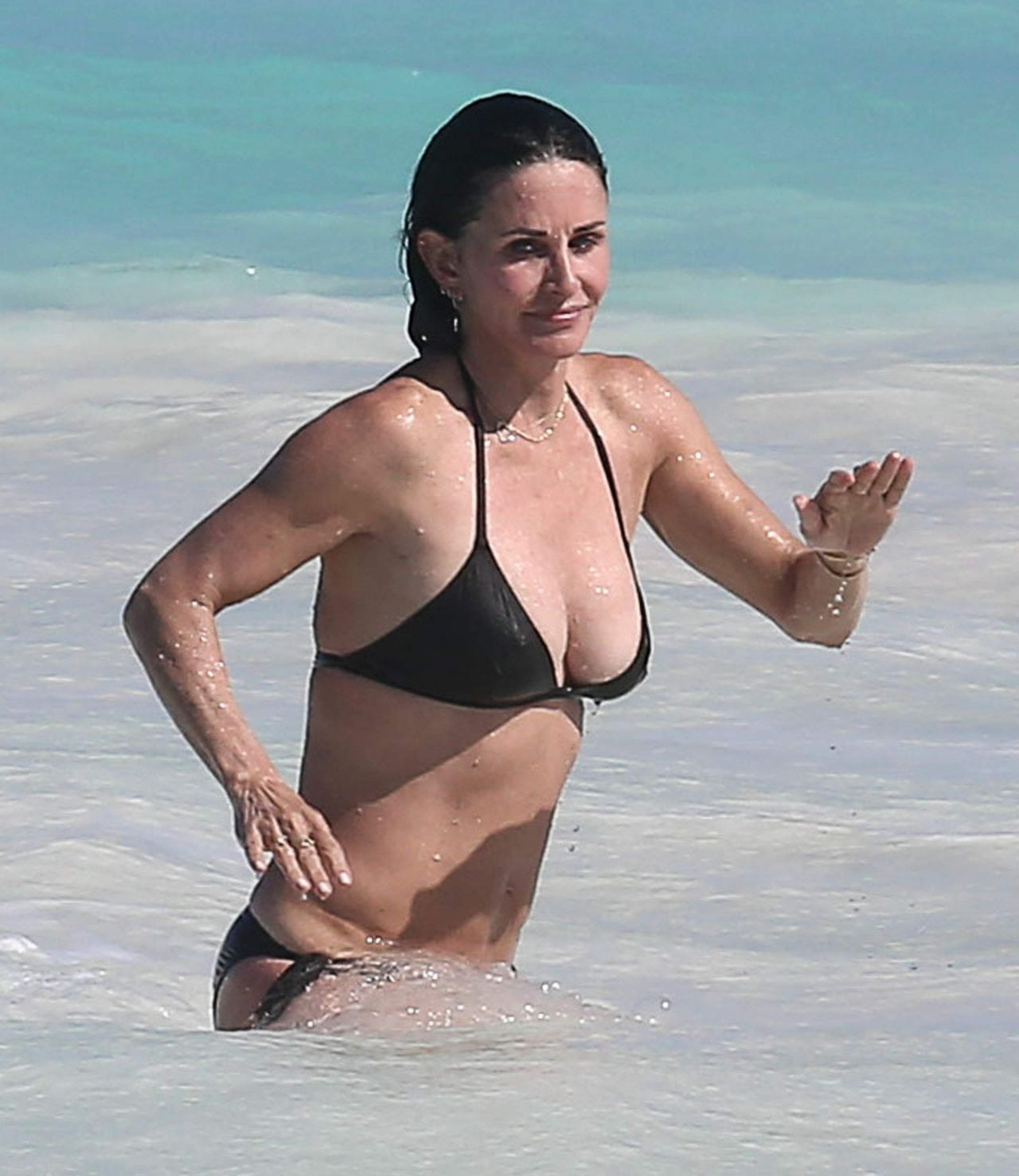 Courteney Cox in Bikini at the Beach in the Bahamas, April ...