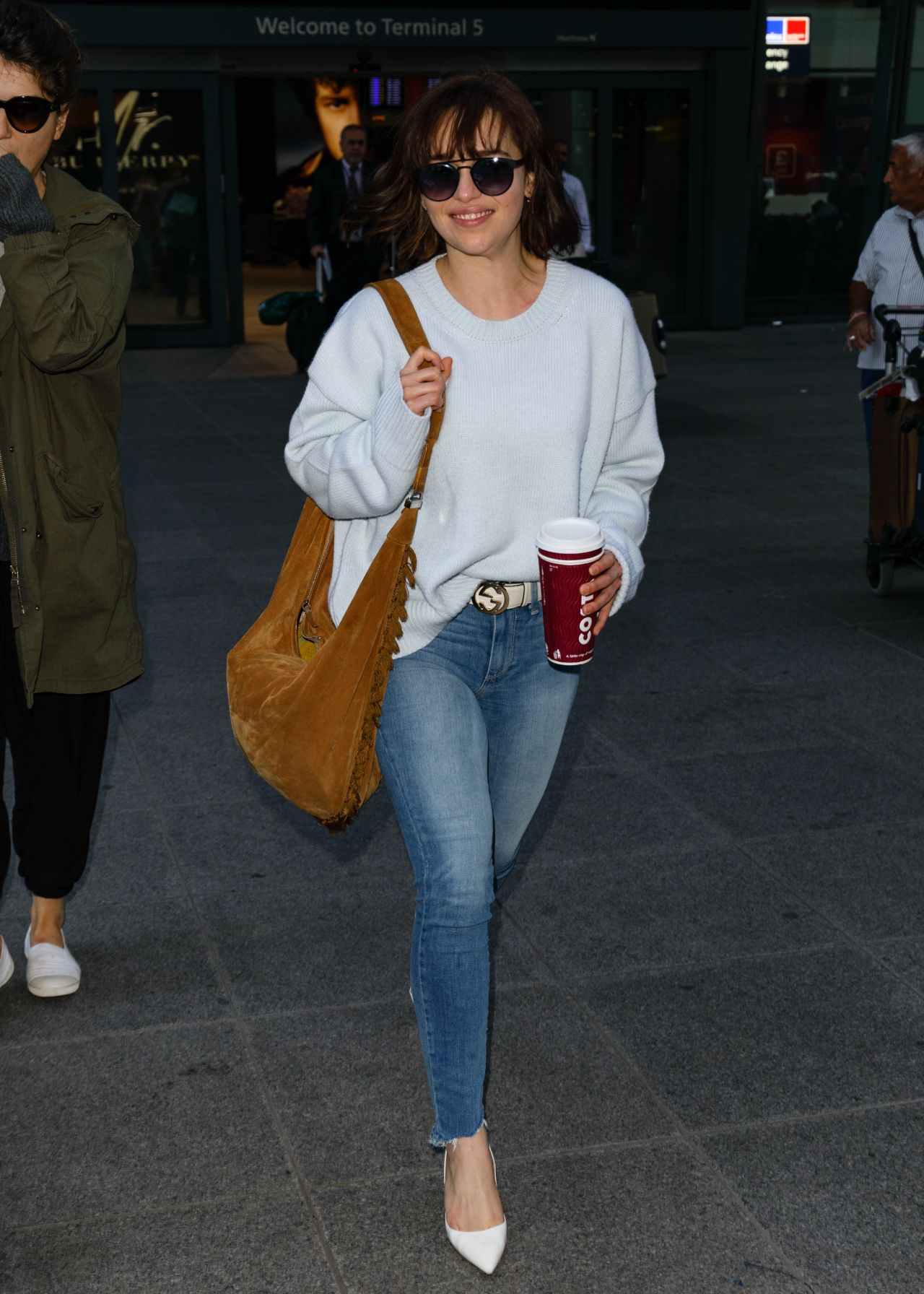 Emilia Clarke in Tight Jeans - Arriving at Heathrow ...