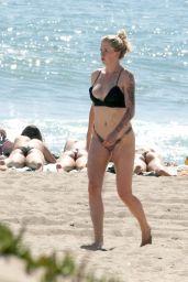 Ireland Baldwin Wearing a Black Bikini in Malibu Beach 4/15/2017