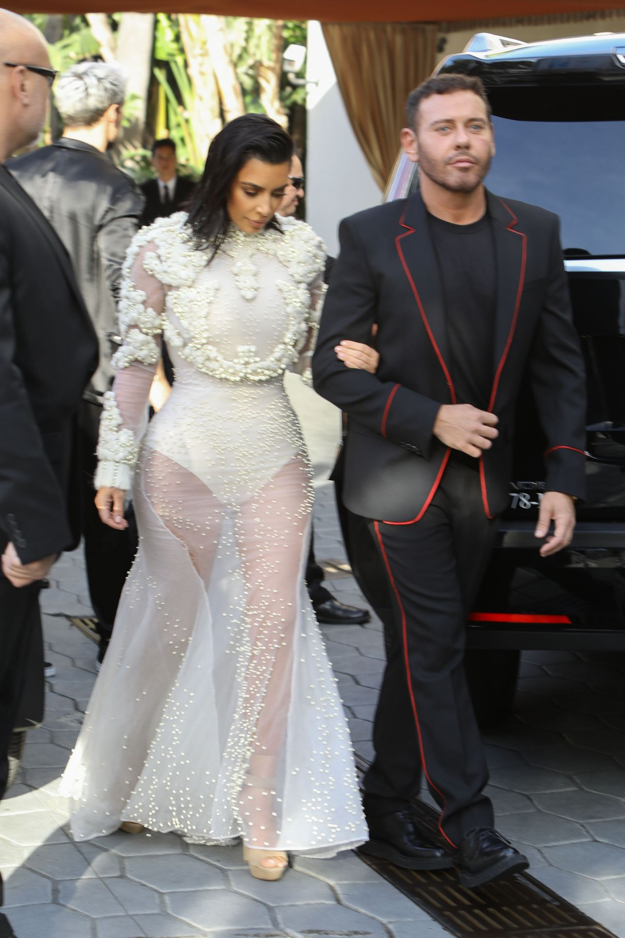 Kim kardashian in sheer givenchy gown at dinner with mert alas