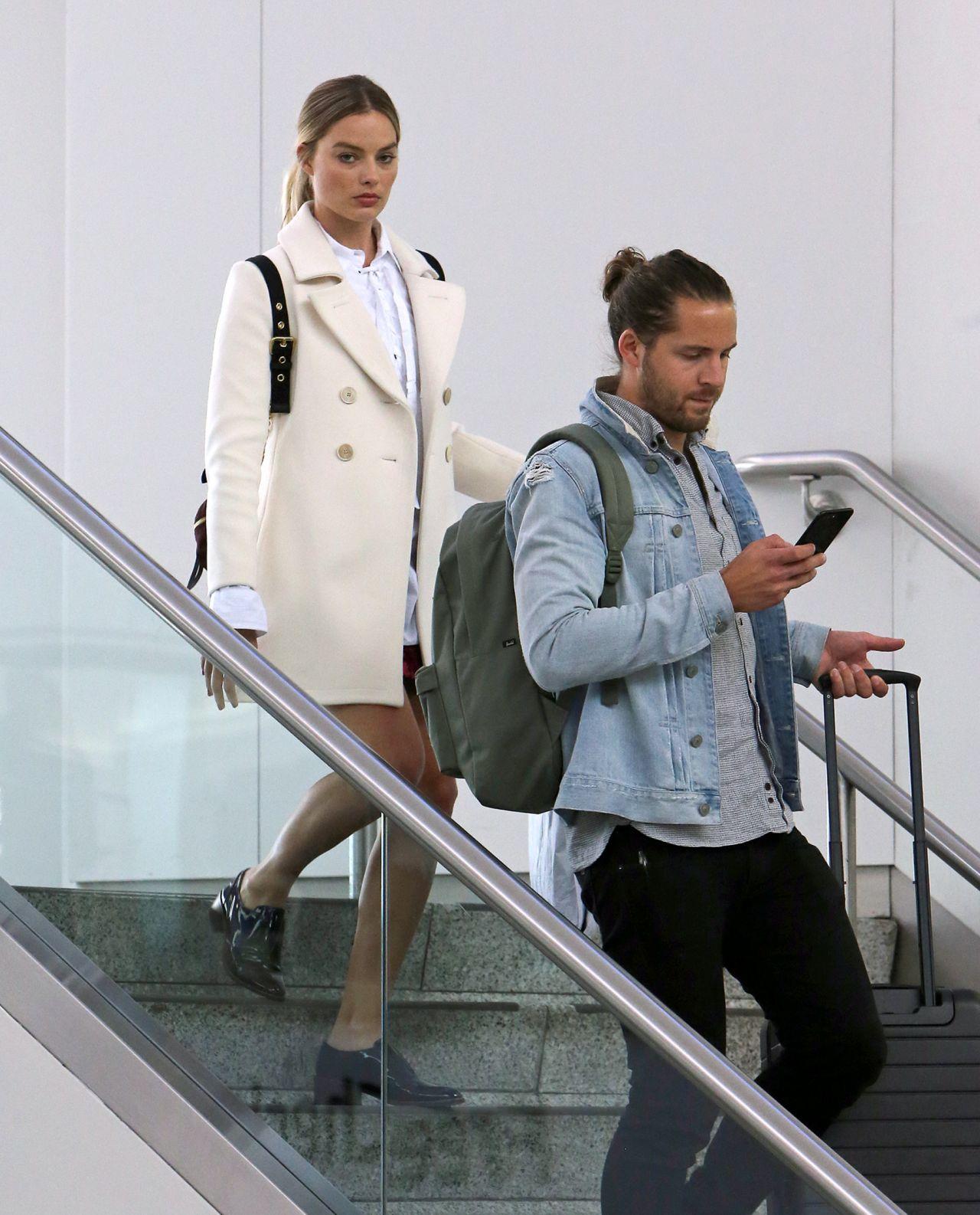Margot Robbie And Husband Tom Ackerley Catch A Flight