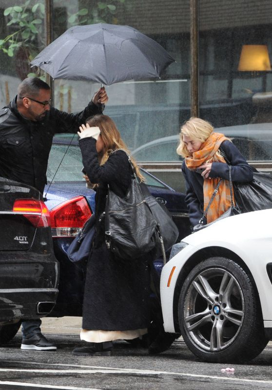Mary-Kate Olsen and Ashley Olsen - Leaving office on Rainy Day in NYC 04/25/2017
