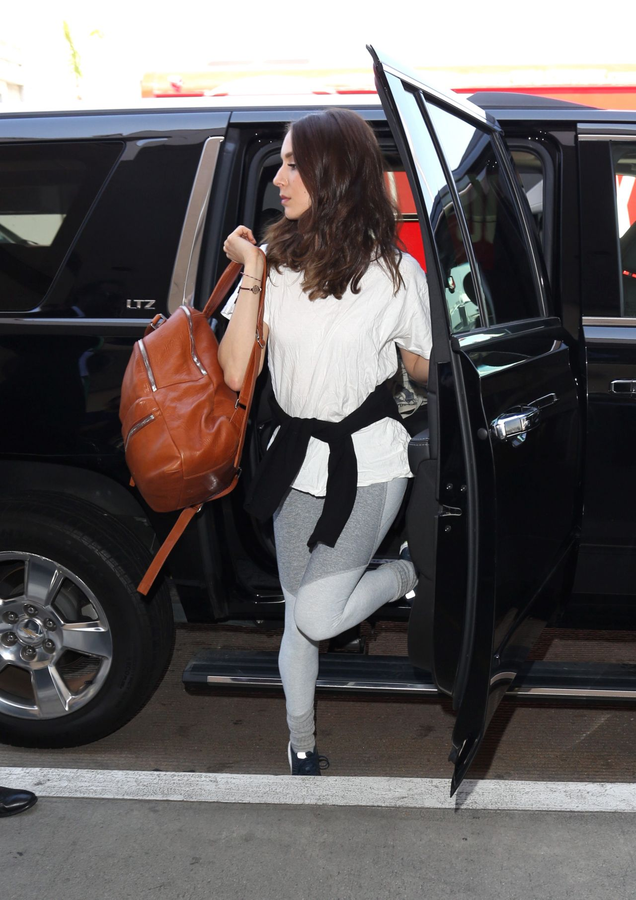 Troian bellisario travel outfit at lax airport - 2019 year