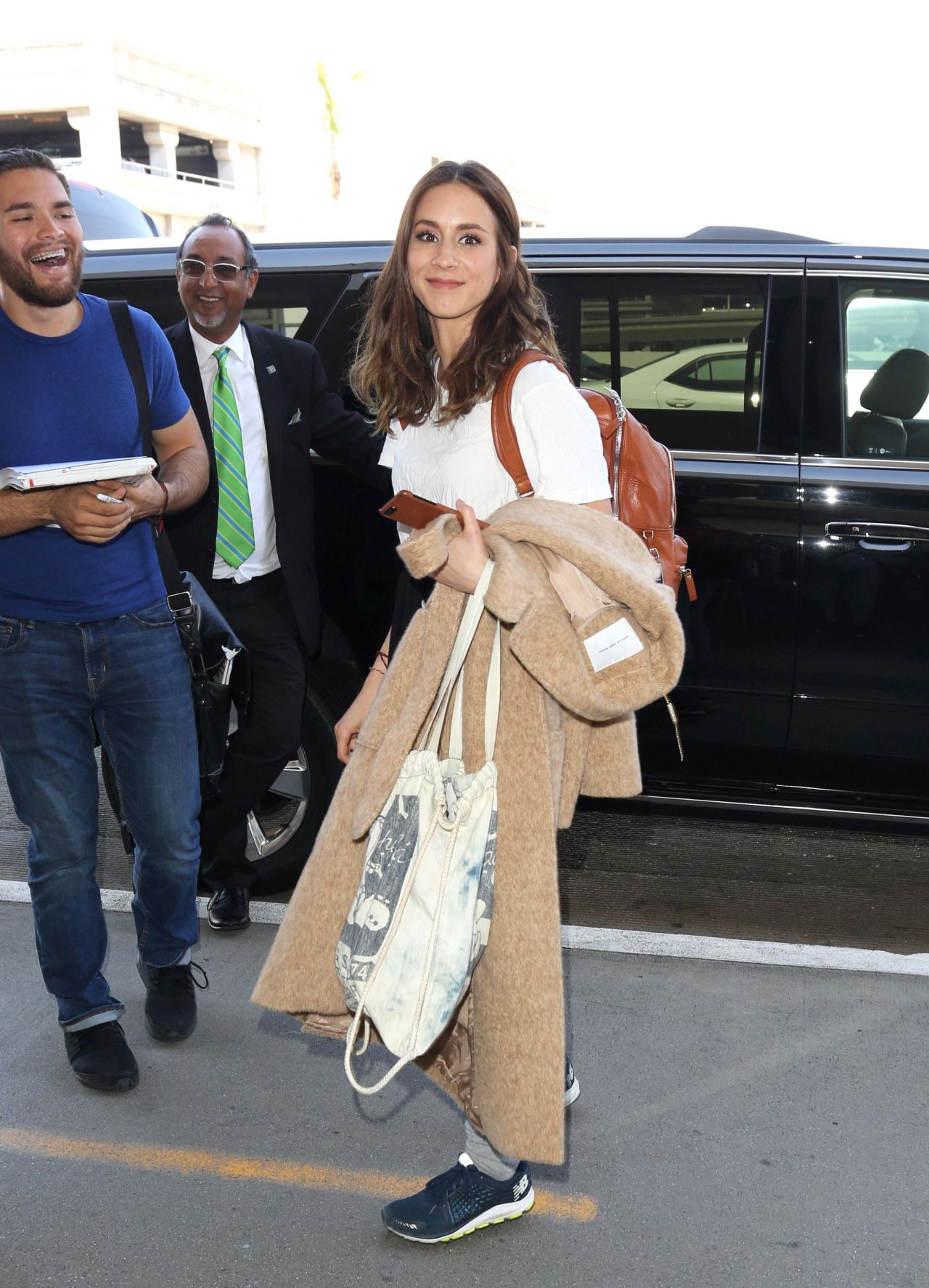Troian bellisario travel outfit at lax airport