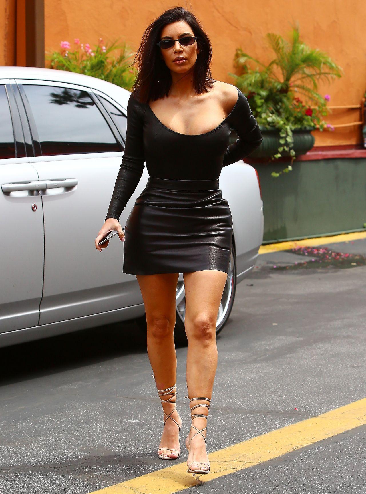 Kim Kardashian West looks stunning in a skin tight yellow