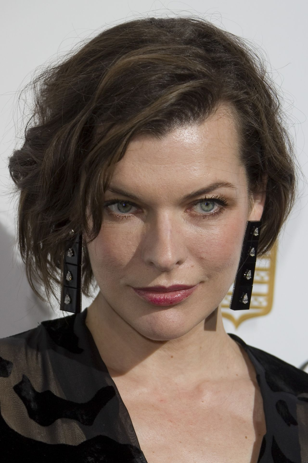 Milla Jovovich - Love On The Rocks Photocall Party at Eden ... Milla Jovovich
