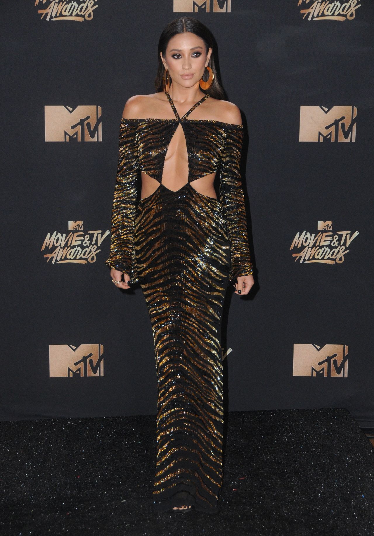 http://celebmafia.com/wp-content/uploads/2017/05/shay-mitchell-mtv-movie-and-tv-awards-in-los-angeles-05-07-2017-18.jpg