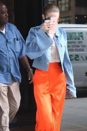 Gigi Hadid - Wearing a Pair of Orange Trousers in NYC 06/19/2017
