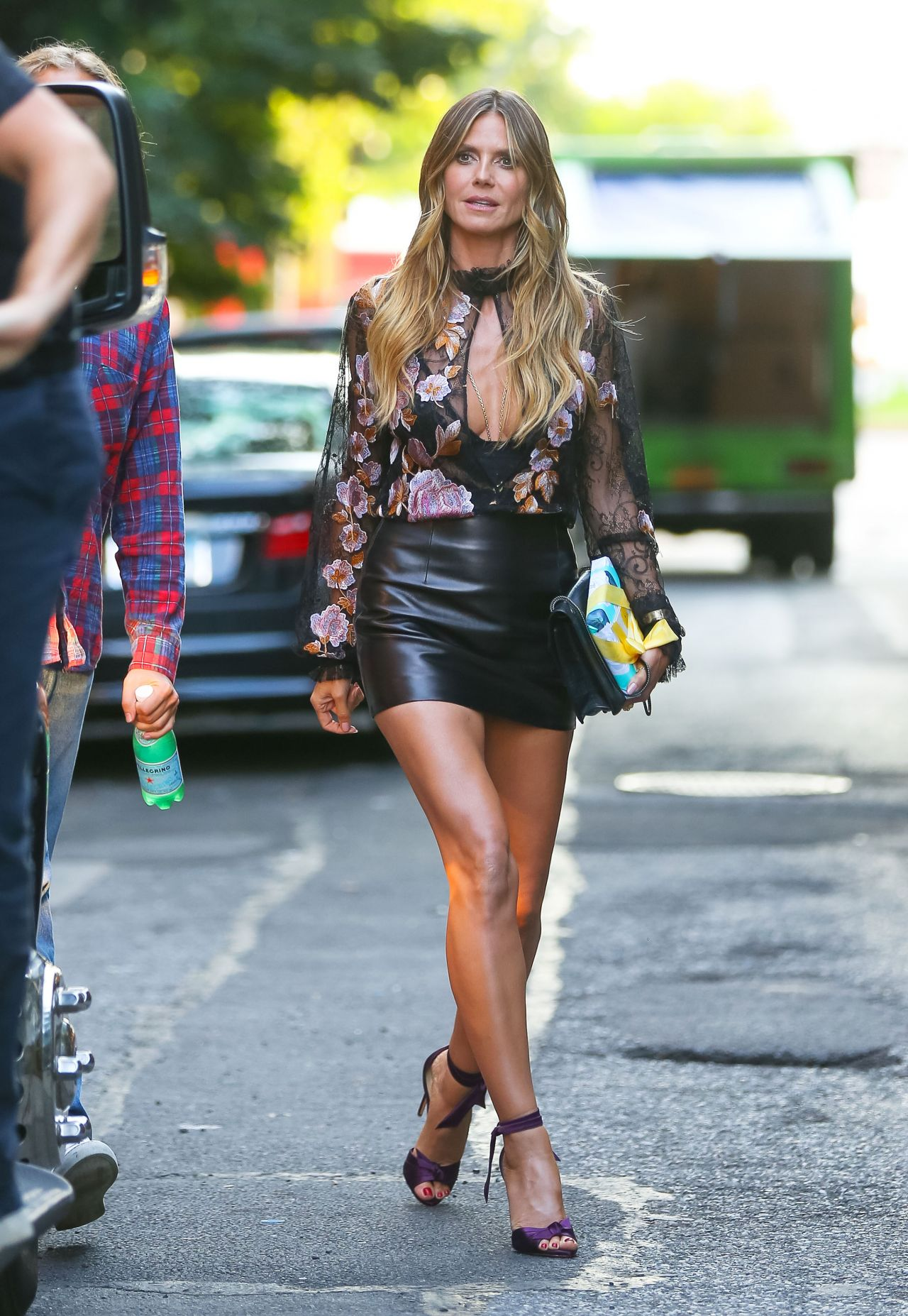 Heidi Klum In A Leather Mini Skirt And Sheer Blouse