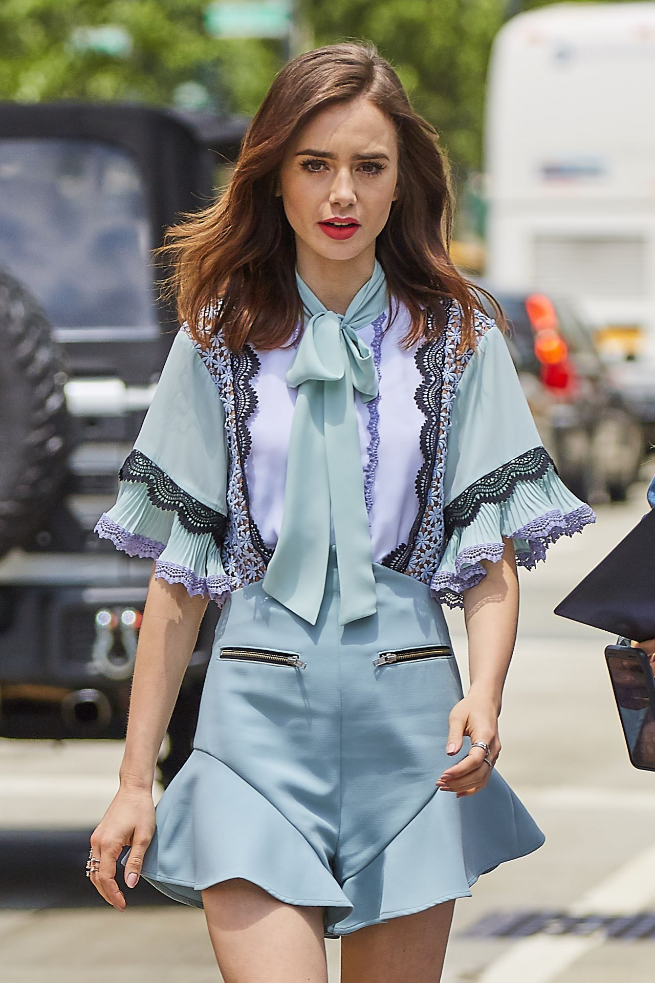 Lily collins in lace trim play suit new york city