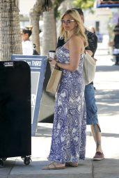 Natasha Henstridge - Grabs a Coffee Whilst Shopping in LA 06/14/2017
