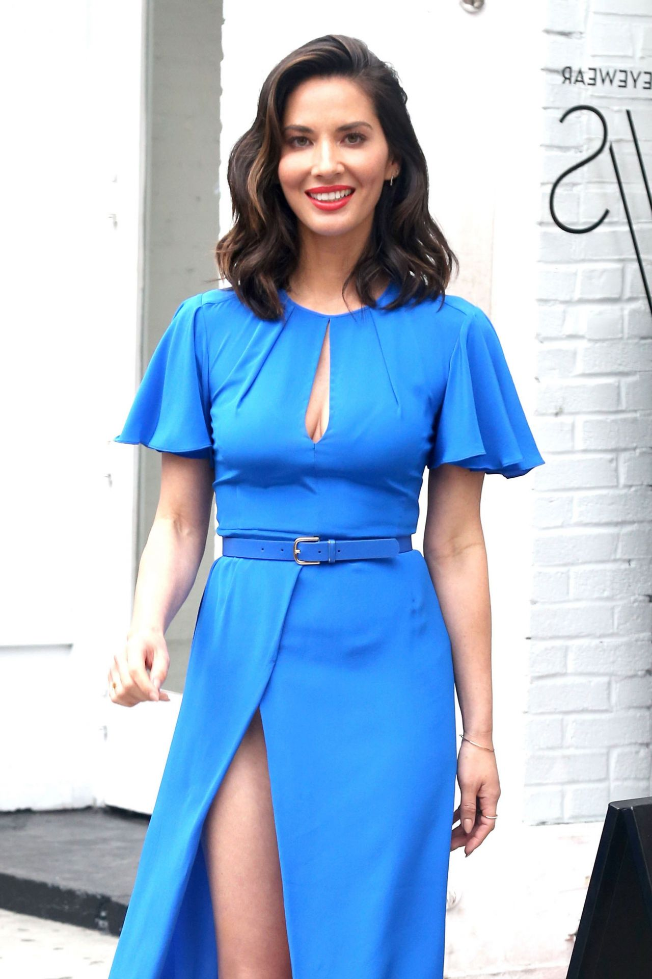 Olivia Munn blue dress, cleavage and heels