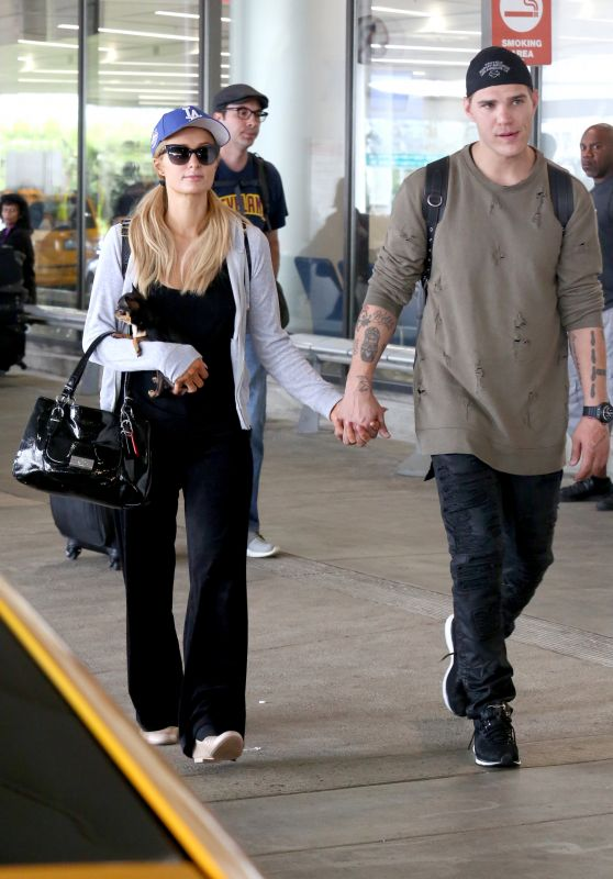 Paris Hilton With Her Boyfriend - LAX Airport 06/11/2017