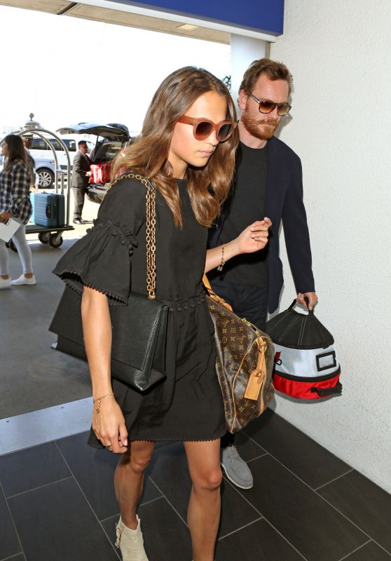 Alicia Vikander and Michael Fassbender - Catch a Flight Out of LAX 07/25/2017