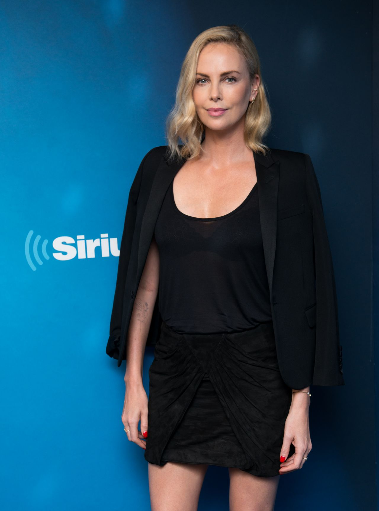 Charlize Theron In Versace For British Vogue: Visits SiriusXM Studios In NYC 07/19/2017