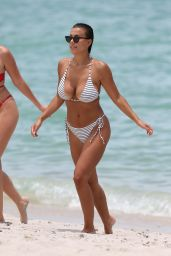 Devin Brugman in a Tiny Striped String Bikini - Beach in Miami, July 2017