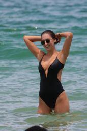 Elsie Hewitt - Wears a Black Swimsuit at the Beach in Miami Beach 07/25/2017