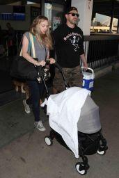 Amanda Seyfried and Thomas Sadoski - Arrive at LAX Airport 08/22/2017